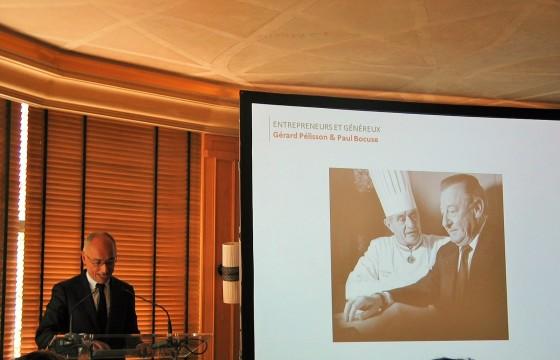 Hervé Fleury, CEO of L'Institut Paul Bocuse, addressing Press at Le Pavillon Ledoyen, photo copyright Paige Donner