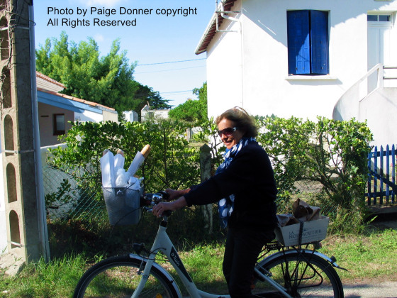 Ile de Noirmoutier - Lady on bicycle with baguette. Photo by Paige Donner copyright 2014 all rights reserved.